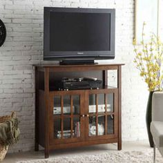 This Big Sur Highboy TV Stand is perfect for a flat panel television plus components and more. Find your home furnishings and organizing products at Stacks and Stacks.