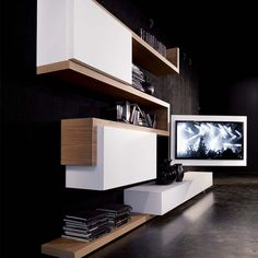 TV Rack cleverly combines media storage and a rotating TV stand into one sleek unit. The composition can be customized in a variety of sizes and finishes.