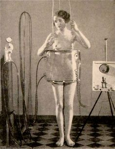 Dr. Flaxlander's pneumatic hip-shaper 1929 I hope he paid her stand for this shot. She is showing no emotion. Aughh ..bet it was Dr. Flaxlander's wife.