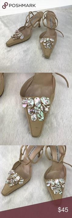 Manolo Blahnik Heels Mother Of Pearl Nude Great wardrobe staple! Has a belt style clasp. Nude ish color heels and it's nice because the mother of pearl picks up the color of your outfit (look for pink prom dress in my closet for example). Very worn condition, there are a lot of scuffs and the heel tips are missing. Please review photos before purchasing.   Items shipped as seen in pictures. 📸 Items may arrive wrinkled from shipping. 💓 Items normally shipped same day if payment is received…