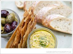 Warm olives, house made hummus, gluten free onion crisps and fresh baked bread on the Cure tasting platter at Cure Lounge Make Hummus, Executive Chef, House Made, Whistler, Freshly Baked, Bread Baking, Olives, Platter, Onion