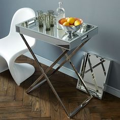 Not sure where.  But I love this mirrored butlers tray on it's shiny, shiny chrome stand.
