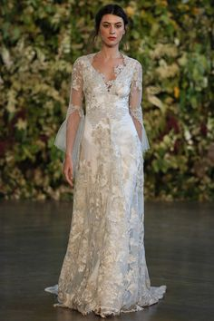 Claire Pettibone Fall 2015 | The gowns have bohemian touches with lace detailing, velvet appliqués, silk embroidery, and flowing sleeves | Ice blue fabrics and details appeared on many gowns reminding us of Frozen's Queen Elsa! |