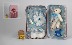 Miniature scene with a teddy bear and mini baby clothes in a