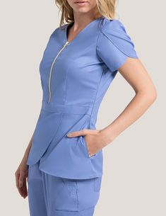 Tulip Top in Ceil Blue is a contemporary addition to women's medical scrub outfits. Shop Jaanuu for scrubs, lab coats and other medical apparel. Healthcare Uniforms, Medical Uniforms, Work Uniforms, Nursing Uniforms, Doctor Scrubs, Spa Uniform, Green Scrubs, Scrubs Outfit, Lab Coats