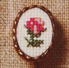 little rose bud - would be cute on a knit blanket