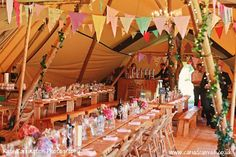 Tipi interior with bunting from Wedding Tipi - photography http://katecarringtonphotography.com/