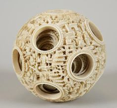 """Lot 2041. Massive antique Chinese carved ivory puzzle ball, 19th c., with approx. 10 concentric inner spheres, 4.5""""dia."""