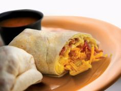 NEW Burgh's Breakfast Burrito | 2 local farm fresh eggs, Cheddar Jack cheese and stuffed with bacon or sausage and hash browns OR, make it a 'Burgh and use French Fries. Served with savory Salsa.