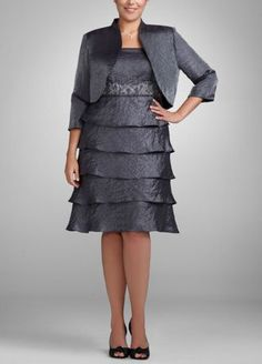 Sophisticated and chic, this two-piece shimmer jacket dress is the perfect go-to for any special occasion.  Tank bodice features elegantly beaded and embroidered waist for added glamour.  Tiered skirt is fashion-forward and flattering.  Optional jacket offers chic coverage without compromising style.  Shimmer fabric is comfortable and radiant.  Fully lined. Back zip. imported polyester blend. Dry clean only.  Also available in missy sizes as Style 056480.  To protect your dress, our Non ...
