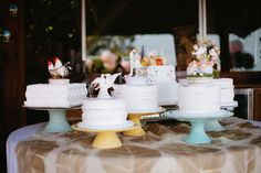 love the dessert buffet - not one formal wedding cake but several on a stand!