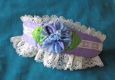 Blue Flower Cuff, Victorian Cuff, Handmade, Antique Lace, Vintage Lace, Blue Millinery Flower,Wristlet, Lavender Silk with Green Silk Leaves by LilliputRoad on Etsy https://www.etsy.com/listing/111611806/blue-flower-cuff-victorian-cuff-handmade