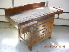 I just picked up an old work bench with a top exactly like this. The base is a simple stand, not a cabinet like this photo.