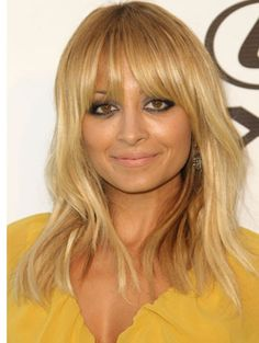 Love Nicole Richie's hair. Try Arreis Cheveux Virgin Indian natural straight hair. We can even match the color.