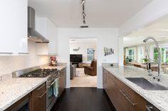 Contemporary Kitchen with Stone Tile, Mazama Hardwood - Handscraped Tropical Collection Manchurian Walnut, Flush, Galley