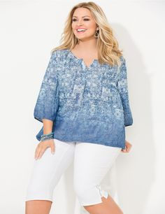 Bay Breeze Peasant | Catherines Our beautiful peasant top features a stylish tribal print with a vertical pattern for a slimming effect. The notched scoop neckline gives way to a three-button henley front. Scoop neckline. Three-quarter sleeves. Catherines tops are perfectly proportioned for the plus size woman. #catherinesplus #plussize #plussizefashion