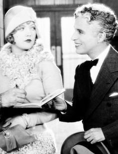 Charlie Chaplin sans Little Tramp costume. With Marion Davies in <i>Show People</i>.