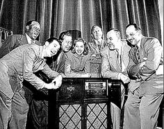 """JACK BENNY"" CAST OF RADIO SHOW. (l.r.) Eddie ""Rochester"" Anderson, Dennis Day, Phil Harris, Mary Livingstone, Jack Benny, Don Wilson, Mel Blanc"