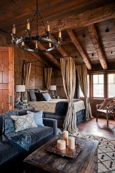 rustic and romantic. I would love to have a master this big to where I could have a couch and coffee table