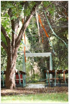 Daily Pretty:  Vintage inspired fabric ceremony structure with damask fabric and scalloped edging. Set deep inside a tree grove with hanging satin ribbons, crystal strands and flower clusters. Iron and wood barrel wood chairs are finished in coordinating ribbons. Image by @Julie Forrest Hamilton #wedding  #ceremony #vintageinspired #ribbons