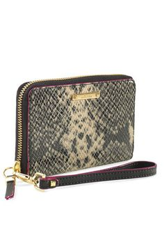 What woman wouldn't love this Stella and Dot clutch? It has room for her money, cards, and even a slot for her phone!