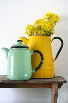 Vintage European Enamel Teapot in Jade Green I picked up a small enamelware pitcher today, will be painting it ivory and using as a vase for one of the bridesmaid bouquets, I only need 2 or 3 more small pitchers .
