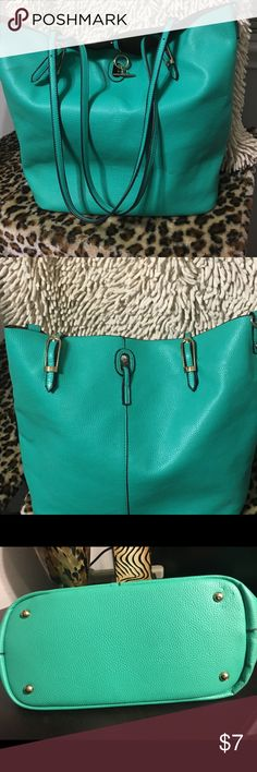 EUC Turquoise Purse Excellent Condition.  Man made faux leather material  Gold tone hardware Cognac felt lining  It's a fun purse for the weekend or to use as a beach bag.  Small flaw on strap. See last photo. It's not noticeable. unmarked Bags Shoulder Bags