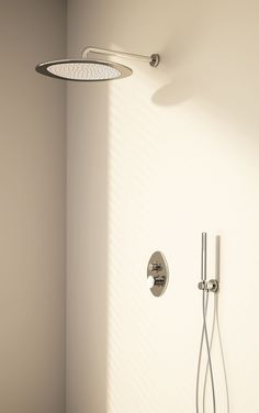 Wall-mounted shower head with inner part in DuPont™ Corian®, Chrome + Glacier White Corian® finishing, wall-mounted built-in shower mixer with DuPont™ Corian® handle, Chrome + Glacier White Corian® finishing and wall-mounted built-in hand shower set, Chrome finishing