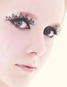 I so want a pair of these. They're paper eyelashes!!!