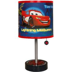 Brighten up your child's room with this adorable Disney Cars Table Lamp. This Disney Cars Lamp imitates a tire, while the shade sports vivid Disney artwork. Your kids will love to turn it on and off over and over again. Car Themed Rooms, Disney Themed Rooms, Disney Cars Room, Disney Pixar Cars, Car Bedroom, Bedroom Themes, Bedroom Ideas, Bedroom Decor, Disney Car Accessories