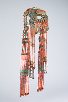 Chakhar Mongol Headdress Geographic Origin Inner Mongolia Medium Silver, coral, turquoise, and other precious stones Dimensions H 27 7/8 x W 9 1/4 x D 7 5/8 in.