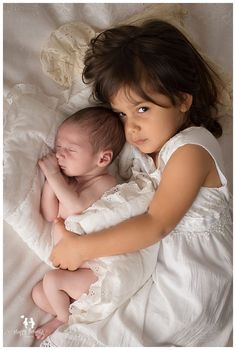 Newborn baby boy with sister photography