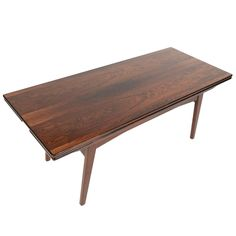 Danish Modern Rosewood Elevation Coffee Table    From a unique collection of antique and modern coffee and cocktail tables at https://www.1stdibs.com/furniture/tables/coffee-tables-cocktail-tables/