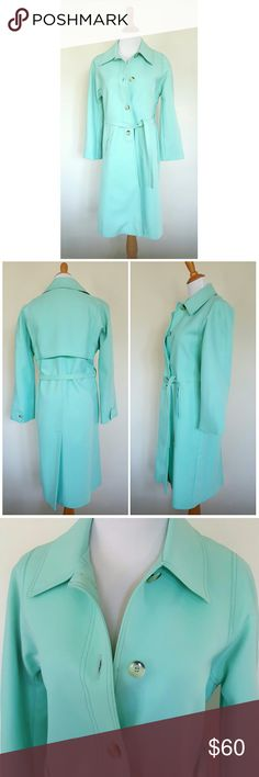 "This Color ♡! Vintage London Fog Beautiful light mint green/light teal aqua London Fog trench coat from the 1970's. It's just so awesome!!   Classic 70's style and 100% polyester. Fully lined with side pockets and slim fabric belt. Buttons intact; there are a few light marks on fabric (see 4th pic).  Vintage size 10 Regular. I wear size 6/8 and on me, I feel like the shoulders are a little small and the sleeves are bracelet length.   Approx measurements: Bust across 18.5"" Waist across 19""…"