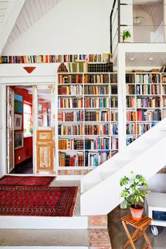 Dream built-in book shelf! Already read books go way up on top, going down to the books that still need to be read. And those stairs...going up to a possible reading nook area?!