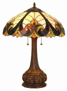Add color to any room in your home with this bronze, base table lamp. Its red, green, and golden hues will warm up your space by casting luminous light about the room, and the two, individually operated bulbs mean that you control the lighting levels.