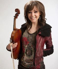 Lindsey Stirling. She is my idol/inspiration because she is unique and never gives up. She is also a motivational speaker. I love how she combines violin, dance and hip hop/dubstep music.