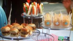 Love this presentation. Easy to munch and mingle: Individual crudités served in glass votive holders & gourmet kettle chips served in mini takeout containers