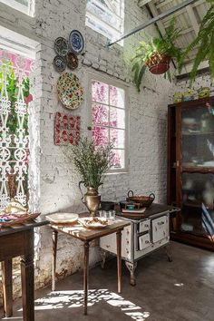vintage fairy kitchen with amazing lattice windows and exposed brick walls