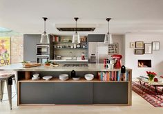 Like use of storage. From Houzz  Urbo bespoke kitchen Winner of the Homes & Gardens Kitchen Designer of the Year Award. Roundhouse Urbo handless bespoke matt lacquer kitchen in Farrow & Ball Downpipe. Worksurface and splashback in Corian, Glacier White and on the island in stainless steel