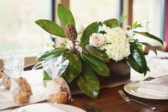 Centerpiece.  Rustic Vintage-Inspired Wedding  Read more - http://www.stylemepretty.com/little-black-book-blog/2014/02/24/rustic-vintage-inspired-wedding/