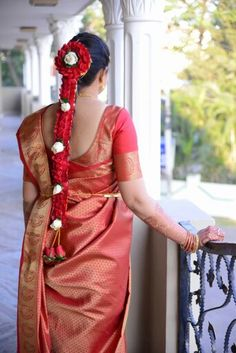 South indian bride's flower-studded braided hair