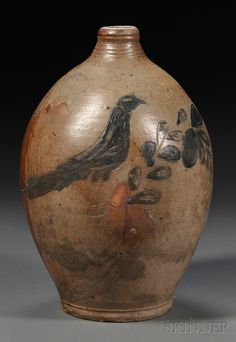 Stoneware Jug with Cobalt-incised Ring-necked Pheasant, possibly one of the Remmey family of potters, New York City or NewYork State, early 19th century, two-gallon oval jug with reeded neck, decorated on one side with an incised and cobalt blue filled design of a ring-necked pheasant perched on an arched flowering leafy branch, and with cobalt-daubed handle terminals, (minor imperfections), ht. 14 1/2 in.