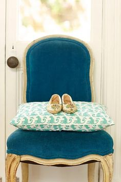 i have a chair that is very similar to this that i want to re-do... maybe i'll do teal velvet...  hmm