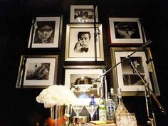 Arrange black and white photos symmetrically for a clean and classic bar area   32 Creative Gallery Wall Ideas To Transform Any Room