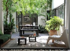 small table (for eating), cool seat and small tables (for relaxing), big plants (patio)
