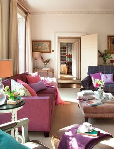 modern pink sofa paired with traditional accents
