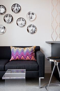 Modern Living Room Design With Charcoal Gray Sofa Fornasetti Plates Wall Decor And Gus