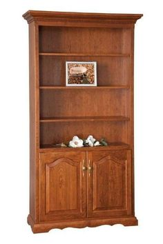 Amish Solid Wood Bookcase with Bottom Doors Wood furniture will set off your book collection beautifully. Made with solid oak, this bookcase is handcrafted for your home. #bookcase #woodfurniture