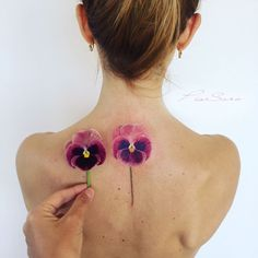 floral watercolor tattoos